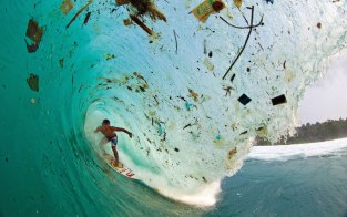 Surfer and Plastic Waste